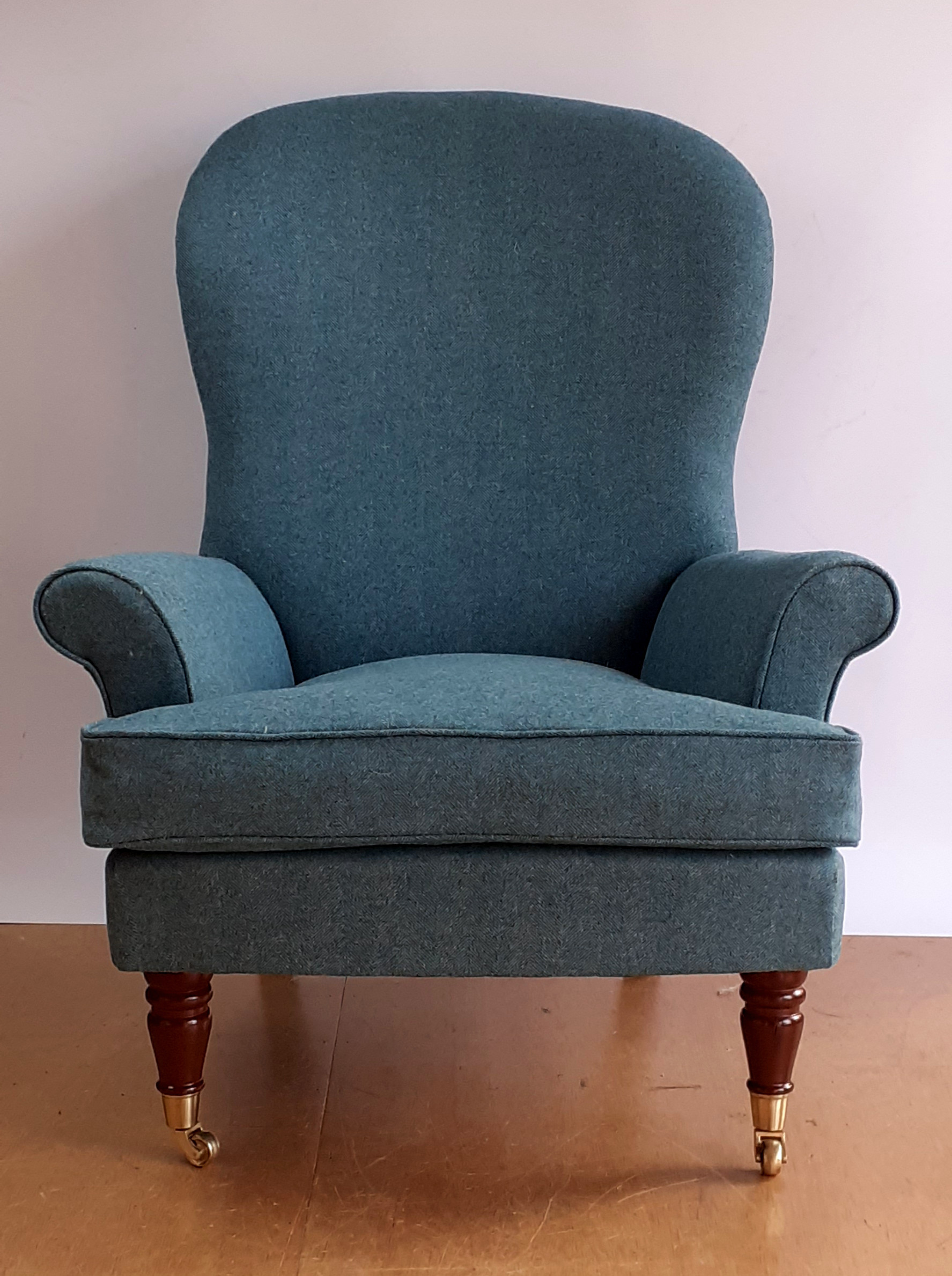 The top fabric is a herringbone weave from Moon - 100% natural wool, a timeless choice for any chair.