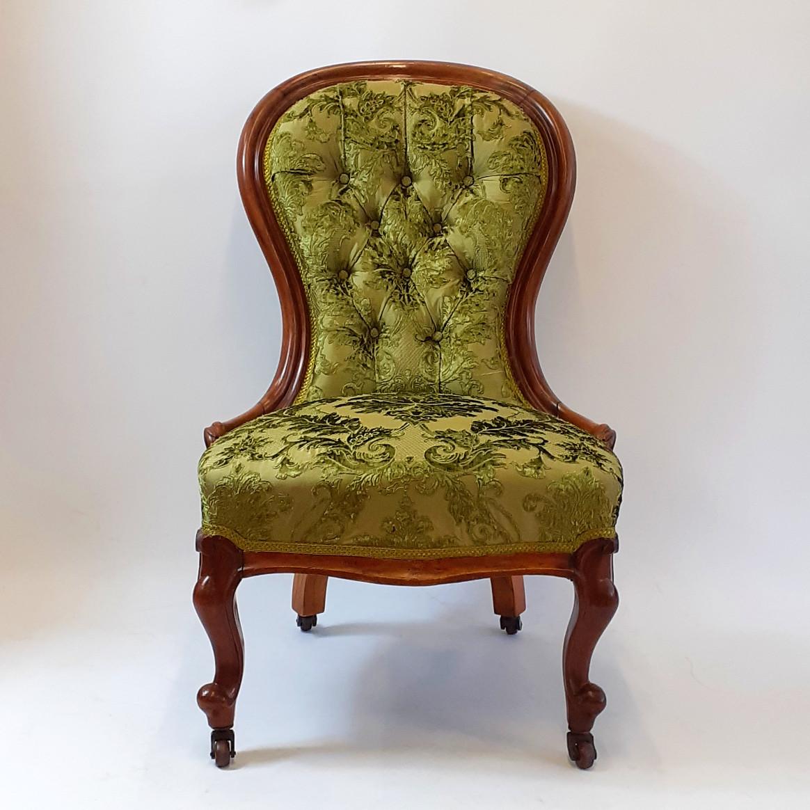Traditionally upholstered nursing chair in silk dupion and velvet