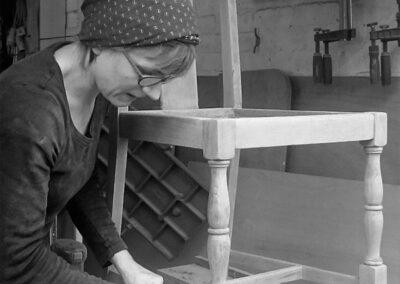 Sarah hand finishing an oak dining chair