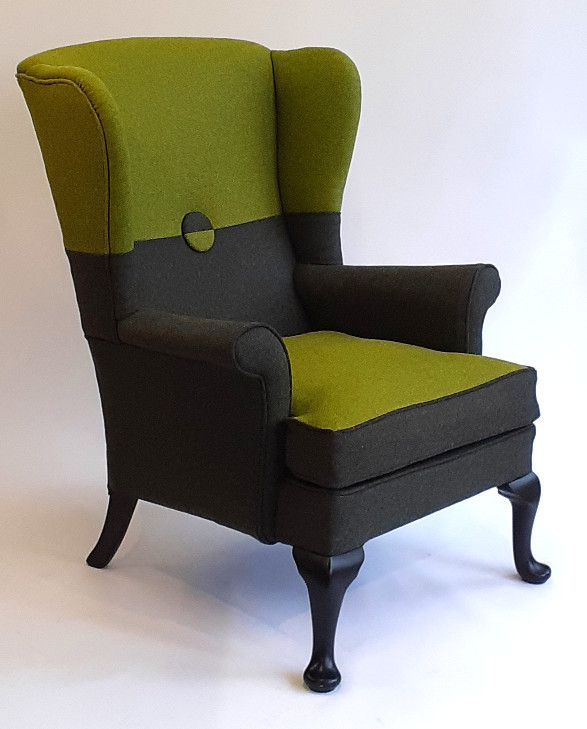 Parker Knoll wing chair in the two tone fabric design.