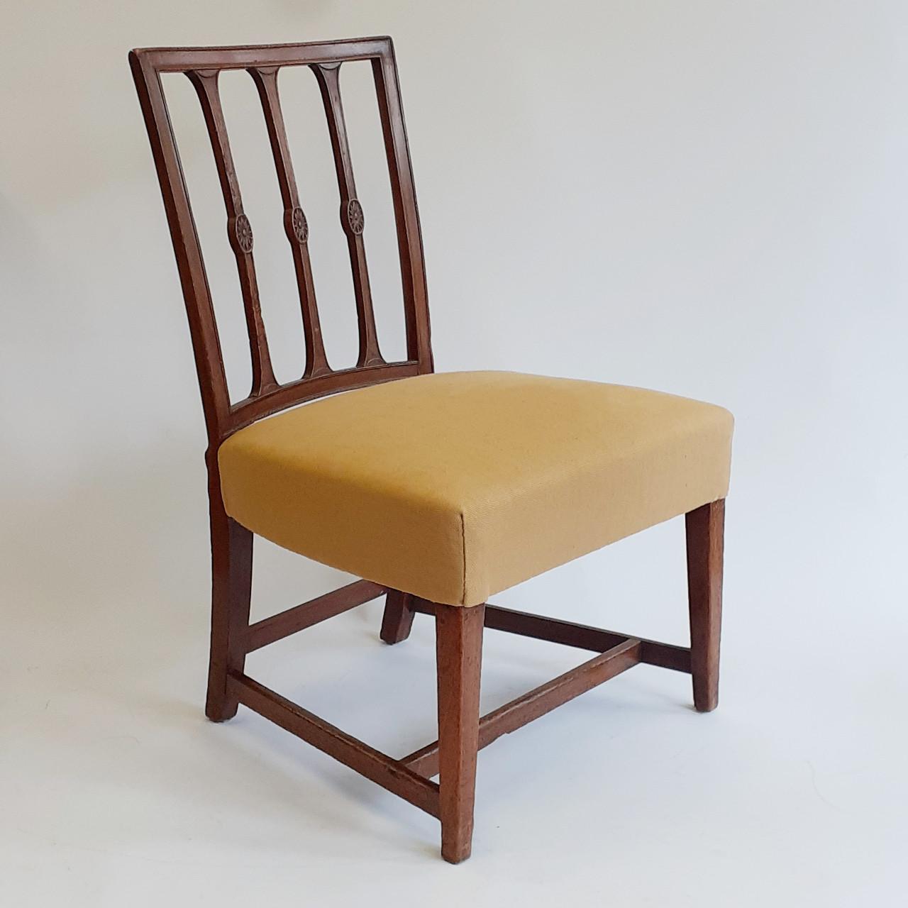 Traditionally upholstered in ochre linen