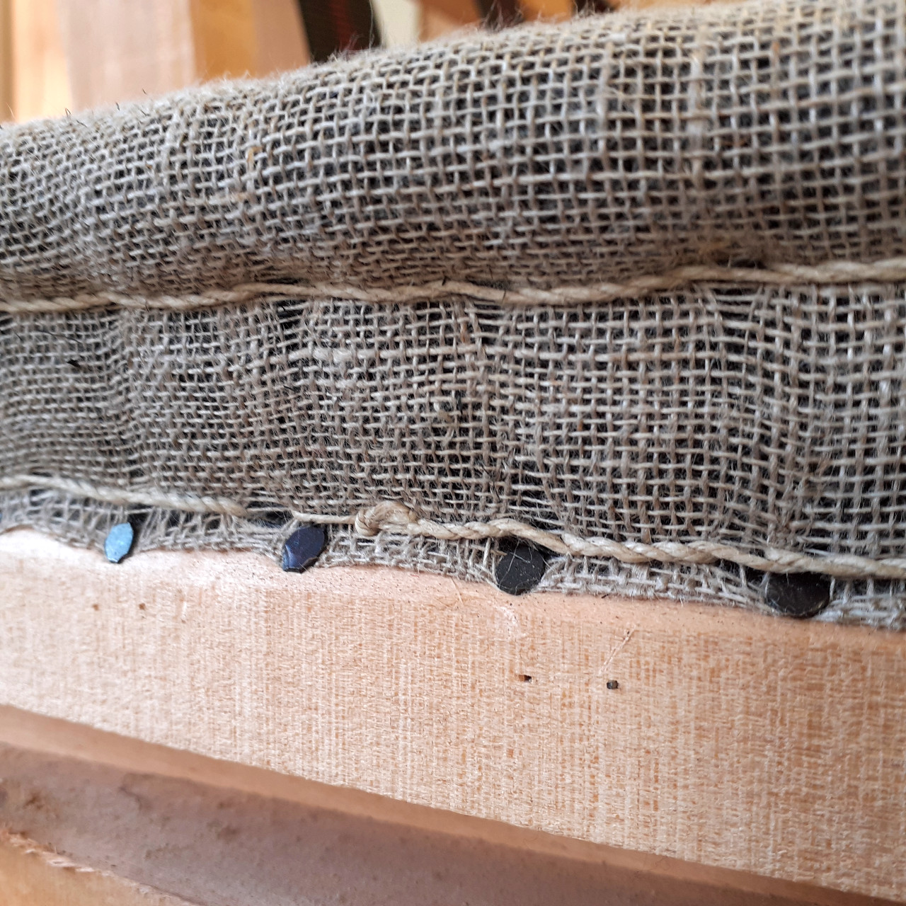 Close detail of a traditional stitched profile but applied to a modern chair.
