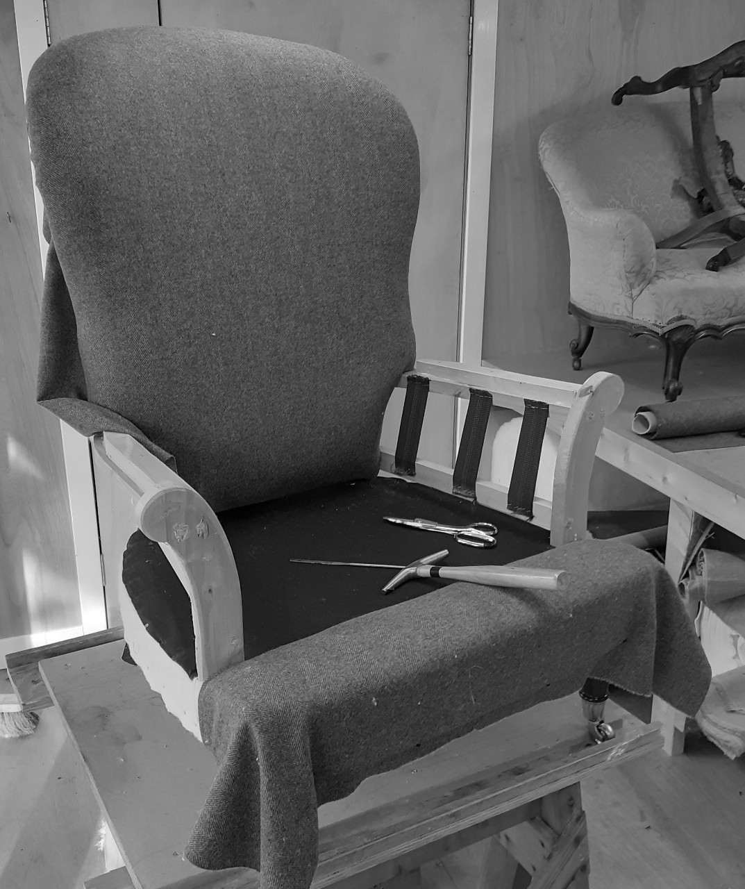 Armchair on the bench with top fabric applied to inside the back.